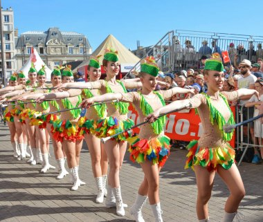 LE MANS, FRANCE - JUNE 16, 2017: Young girls march on the streets at the opening parade of 24 hours of Le mans