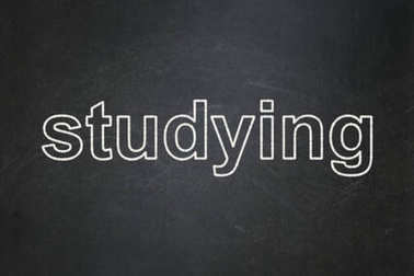 Education concept: Studying on chalkboard background