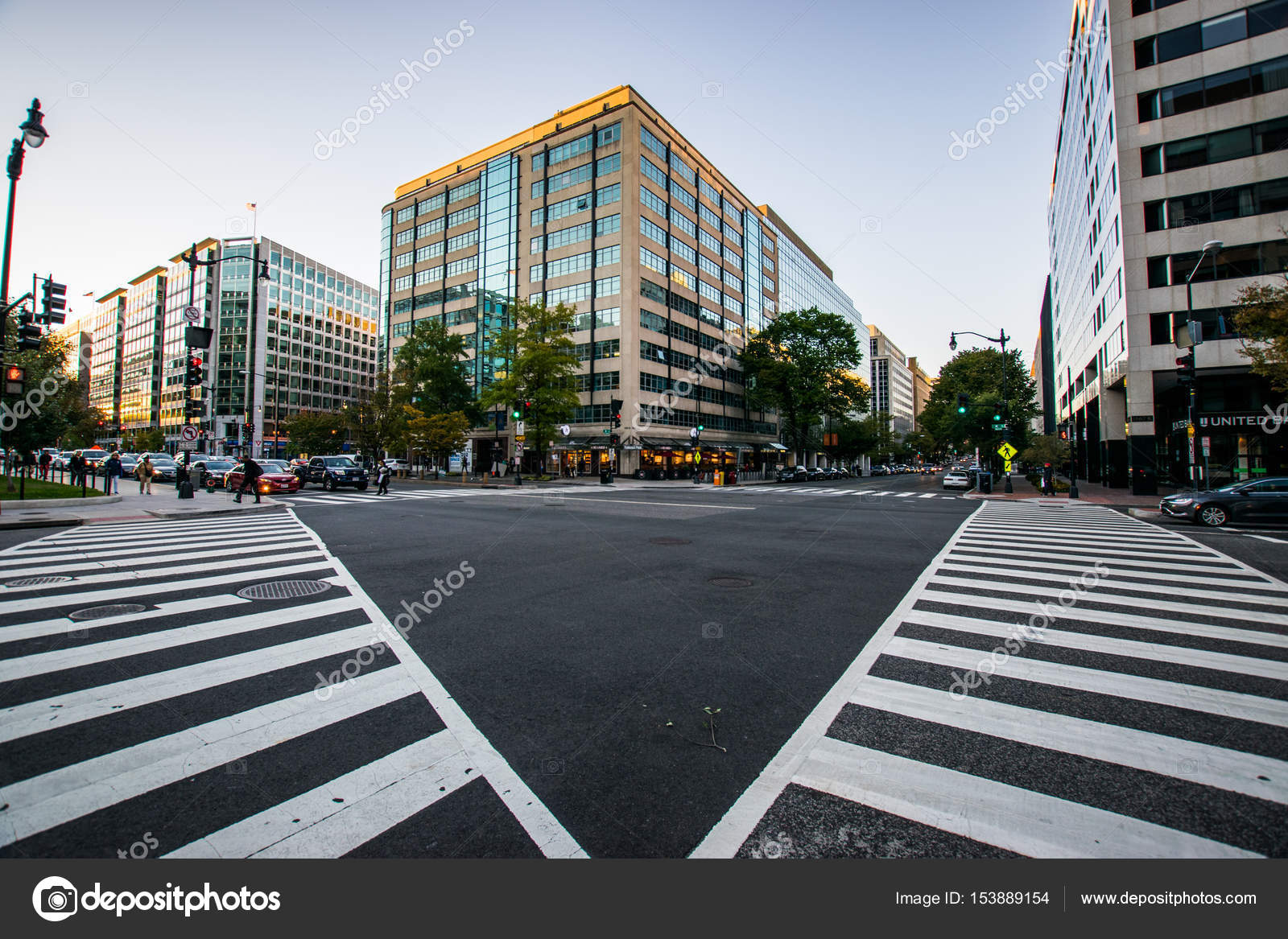Crosswalk framing a building in downtown DC during a warm summer ...