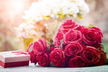 red roses flowers with valentine festival gift and beautiful blu