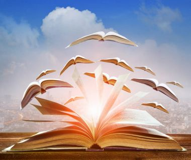 abstract of open book flying as knowledge wisdom going to future
