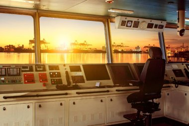 wheelhouse control board of modern industry ship approaching to