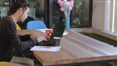Asian young freelance man working in home office