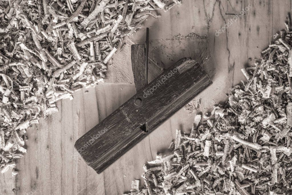 Desk of a carpenter tools. Studio shot on a wooden background.