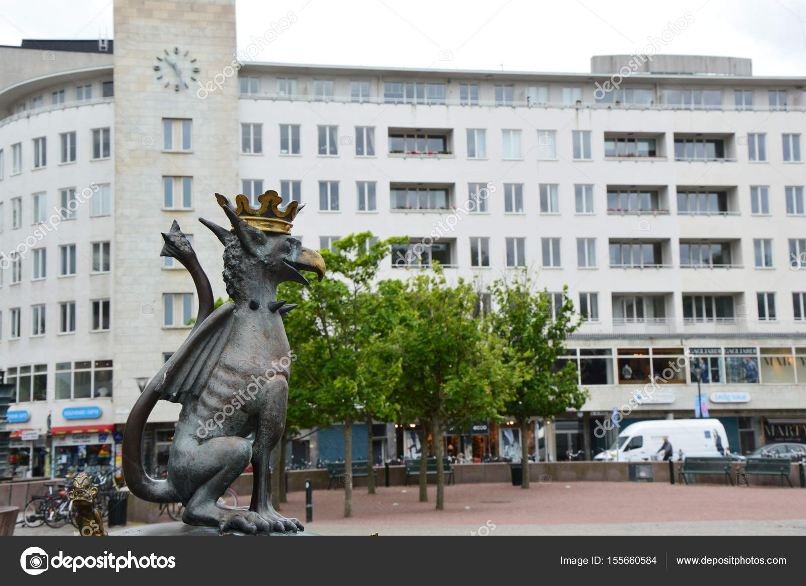 3a0173ff15d2 MALMO, SWEDEN - MAY 31, 2107: Gryphon in the center of Malmo in Gustav  Adolfs Torg square with trees and a great white building with clock on the  background ...