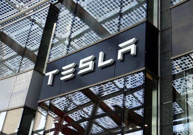 MILAN, ITALY - JULY 19, 2017: Tesla Motors store in Piazza Gae Aulenti square in Milan, Italy
