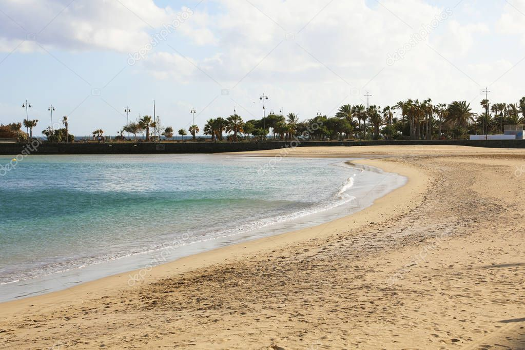 Playa del Reducto beach with palm trees on the background, Arrecife, Lanzarote
