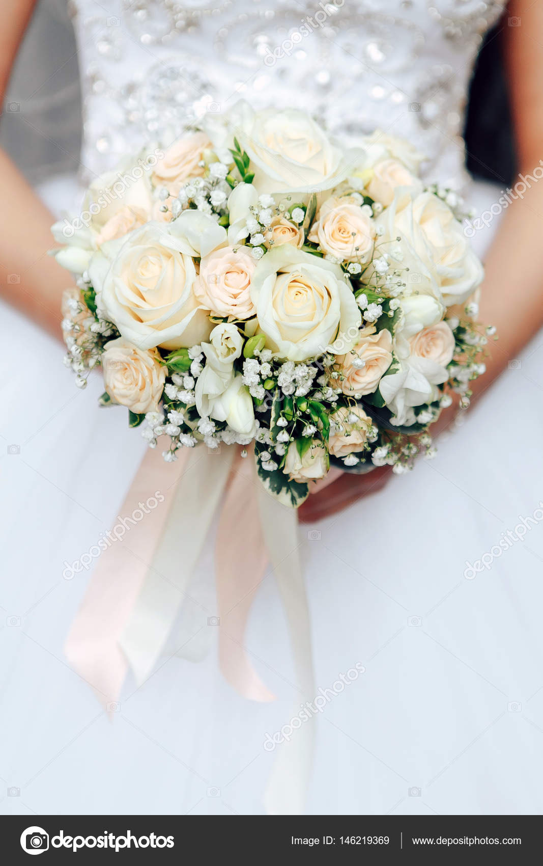 Bride holding a bouquet of flowers in her hand stock photo bride holding a bouquet of flowers in her hand photo by yavlonin izmirmasajfo