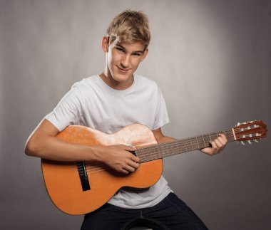 Young man with acoustic guitar