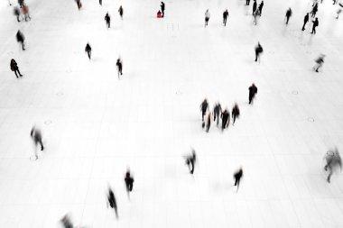 People walk the floor in motion blur