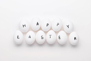 Happy Easter letters on white eggs
