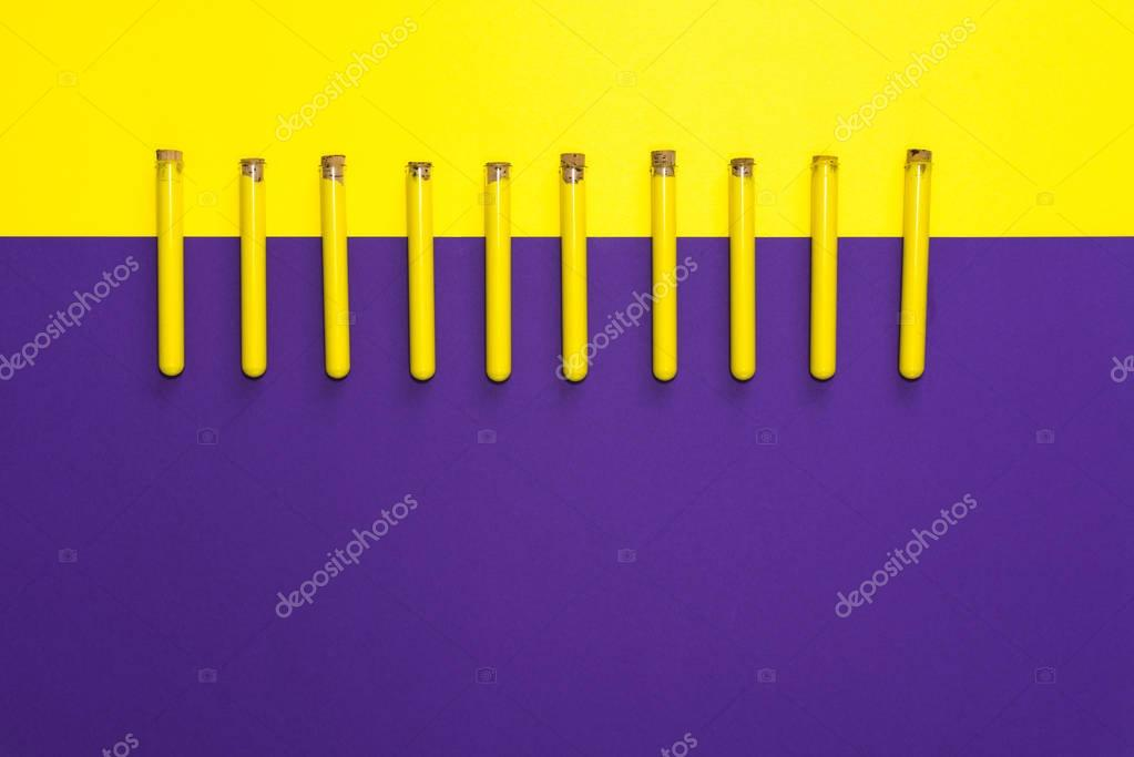 test-tubes with yellow paint