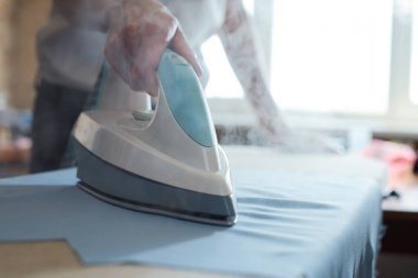 Woman ironing fabcrics