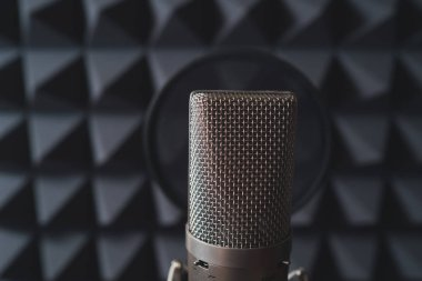 Studio microphone in recording studio with acoustic foam