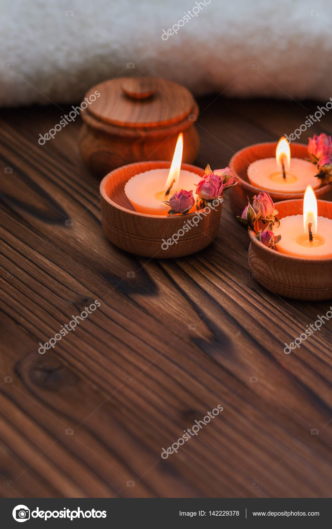 Peach Small Candles In Wooden Cups With Dried Flowers Stock Photo