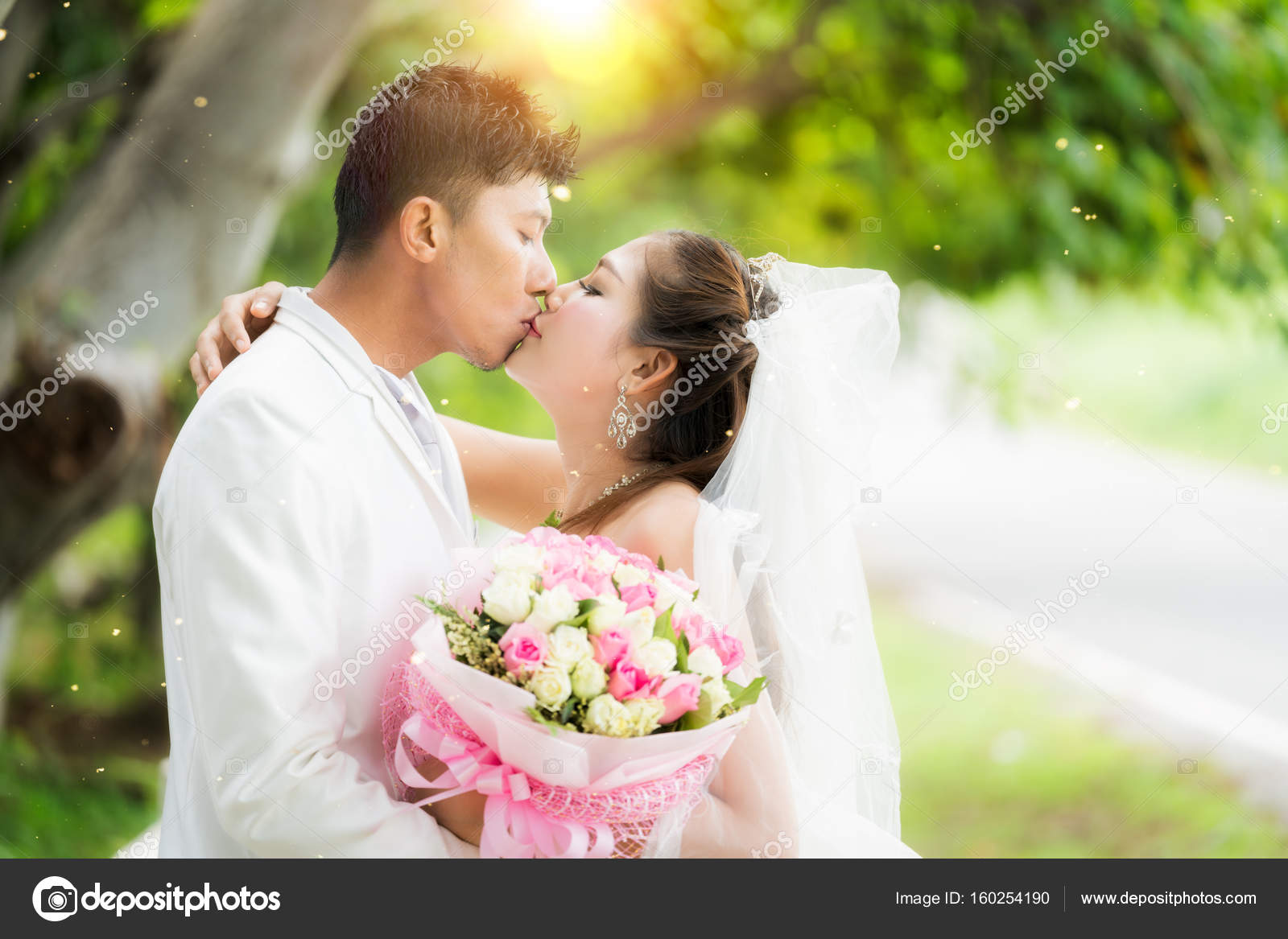 couple just wedding hug and kiss in nature background — stock photo