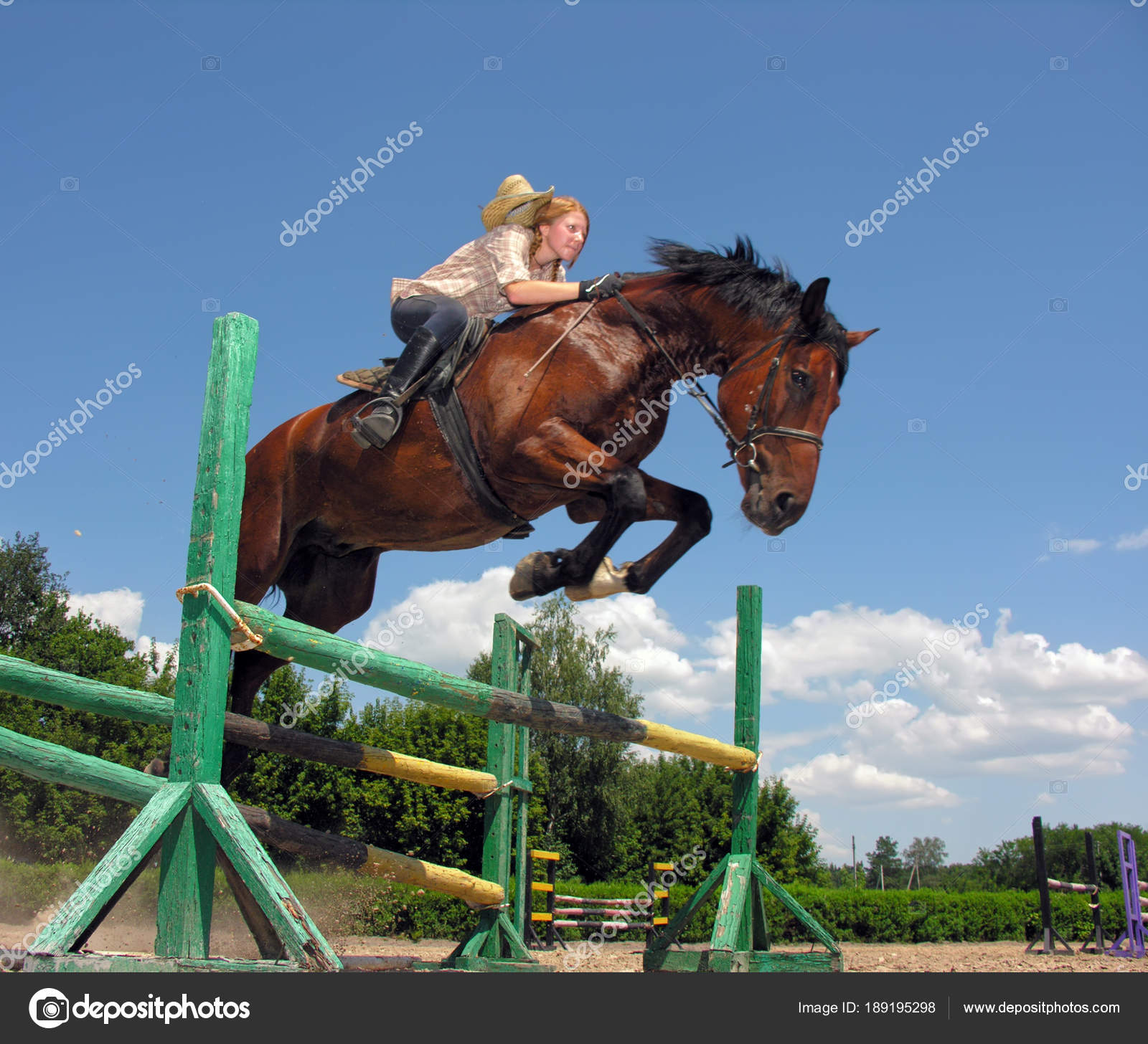 Young Cowgirl Jumping With Chestnut Horse Stock Photo C York010 189195298