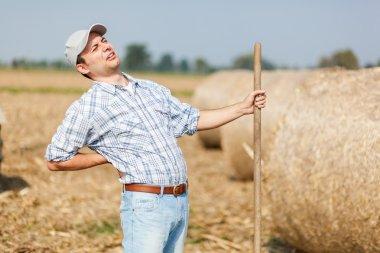 Tired farmer with backache