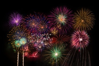 Colourful fireworks on dark background