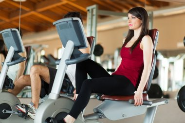 Couple working out on a stationary bikes