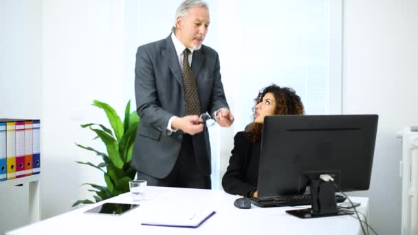 angry businessman at work with businesswoman