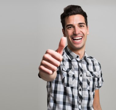 young man giving thumbs up