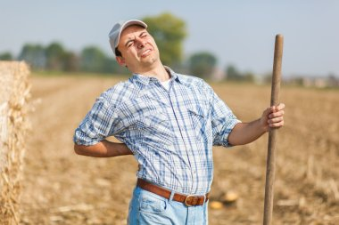 Farmer having back pain