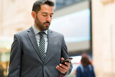 Commuter looking at phone