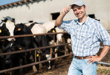 Breeder in front of his cows