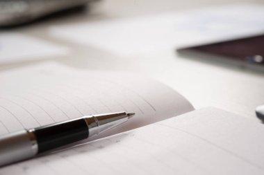 pen on an empty agenda page