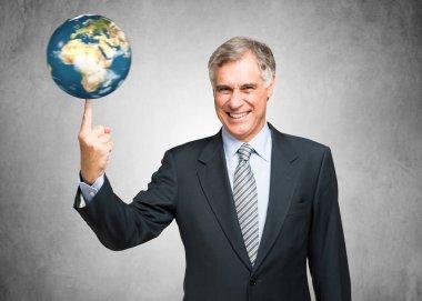 Businessman spinning a globe on finger
