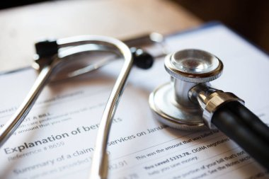 Stethoscope and medical documents