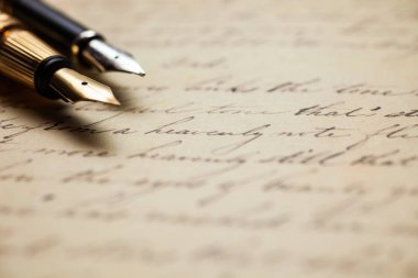Fountain pens and antique handwritten letter