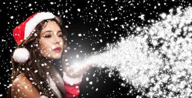 Christmas girl breathing magic snow