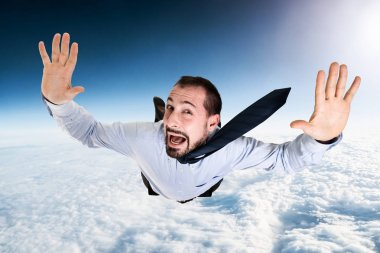 Terrified businessman falling from sky