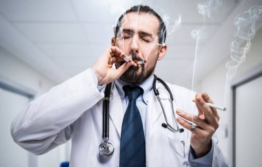 Stressed doctor smoking many cigarettes