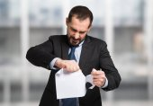 Fotografie Angry businessman tearing up document