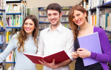 Smiling students in university library