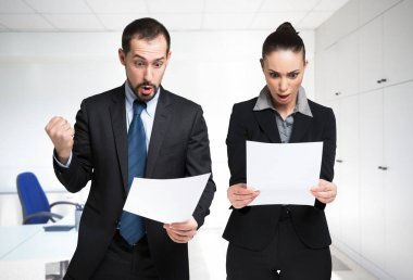 Business people looking at a documents