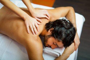 Man relaxing in wellness center