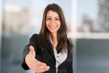 Businesswoman offering an handshake