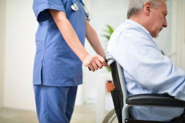 Nurse pushing patients wheelchair