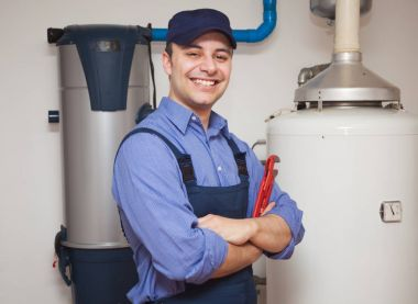 Plumber with wrench smiling