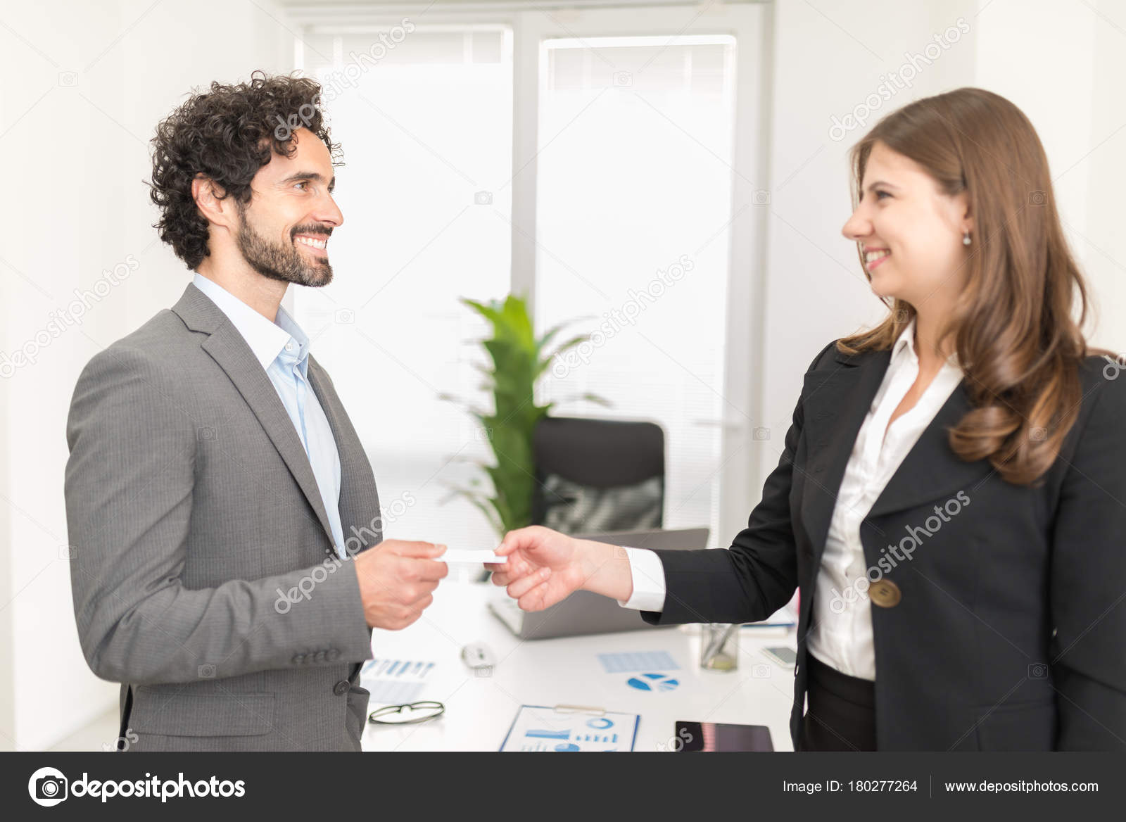 People exchanging business cards stock photo minervastock 180277264 people exchanging business cards stock photo colourmoves