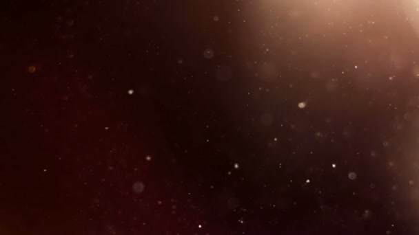 Pohybující se částice. Zlaté a červené odstín