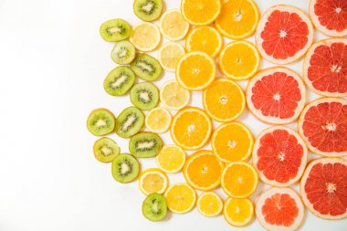 Gradient color citrus slices on white background