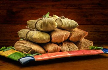Mexican tamales made of corn chicken pork and chili