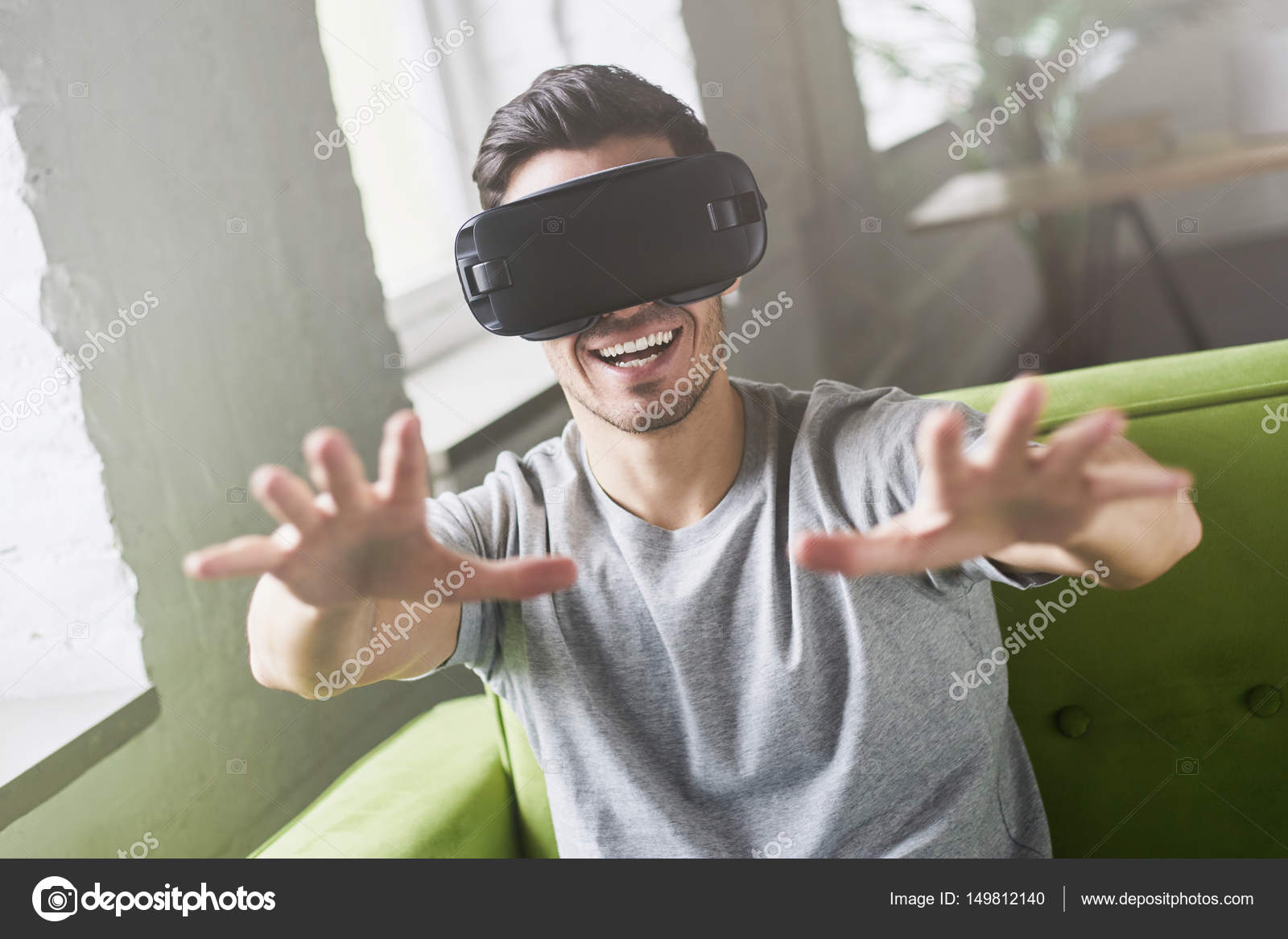 226da387fc1 Close up portrait of astonished handsome guy experiencing virtual reality  while using oculus rift headset for entertaining