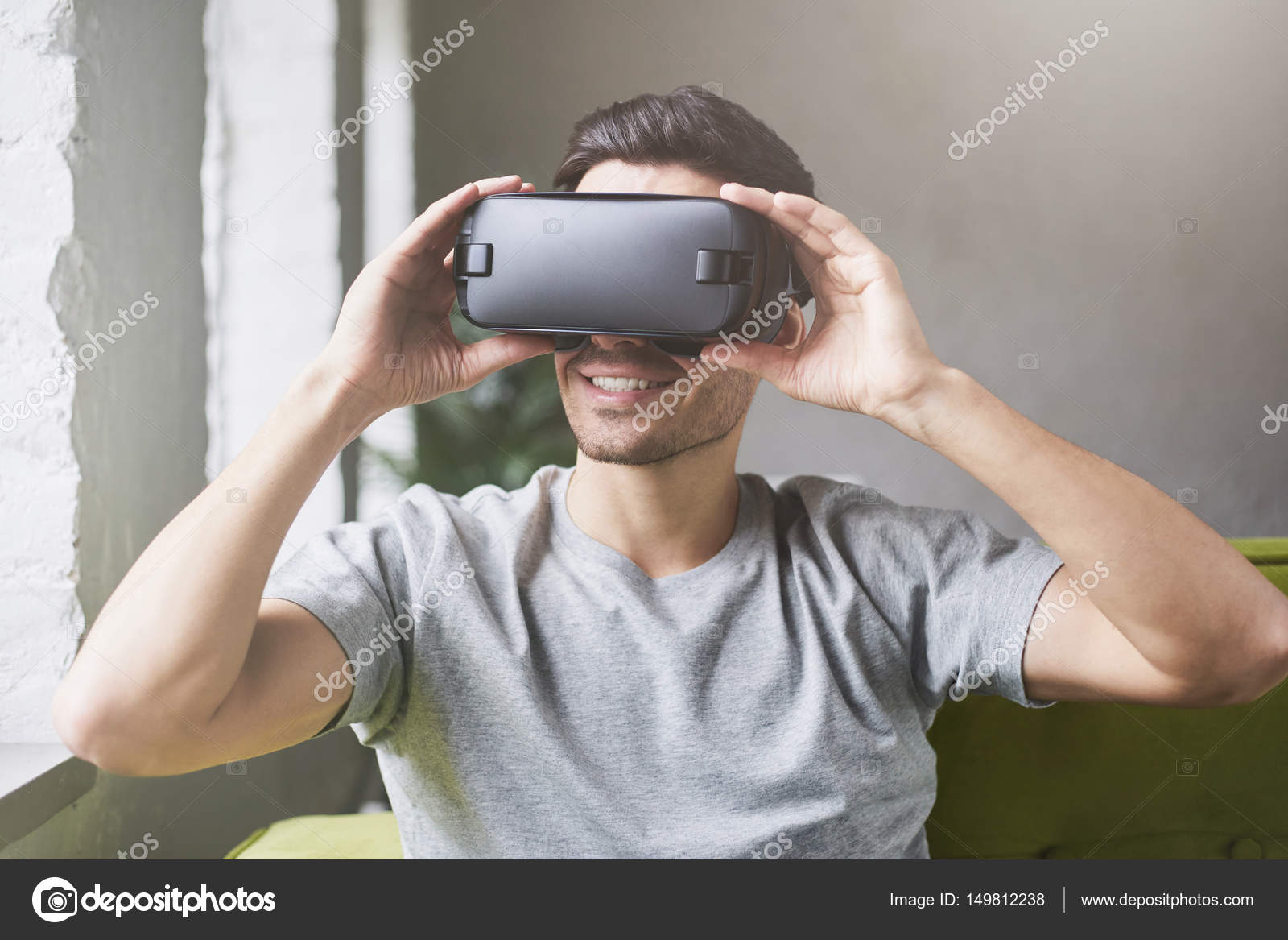 2c94f118af9 Close up of caucasian male wearing grey t-shirt and goggles ...