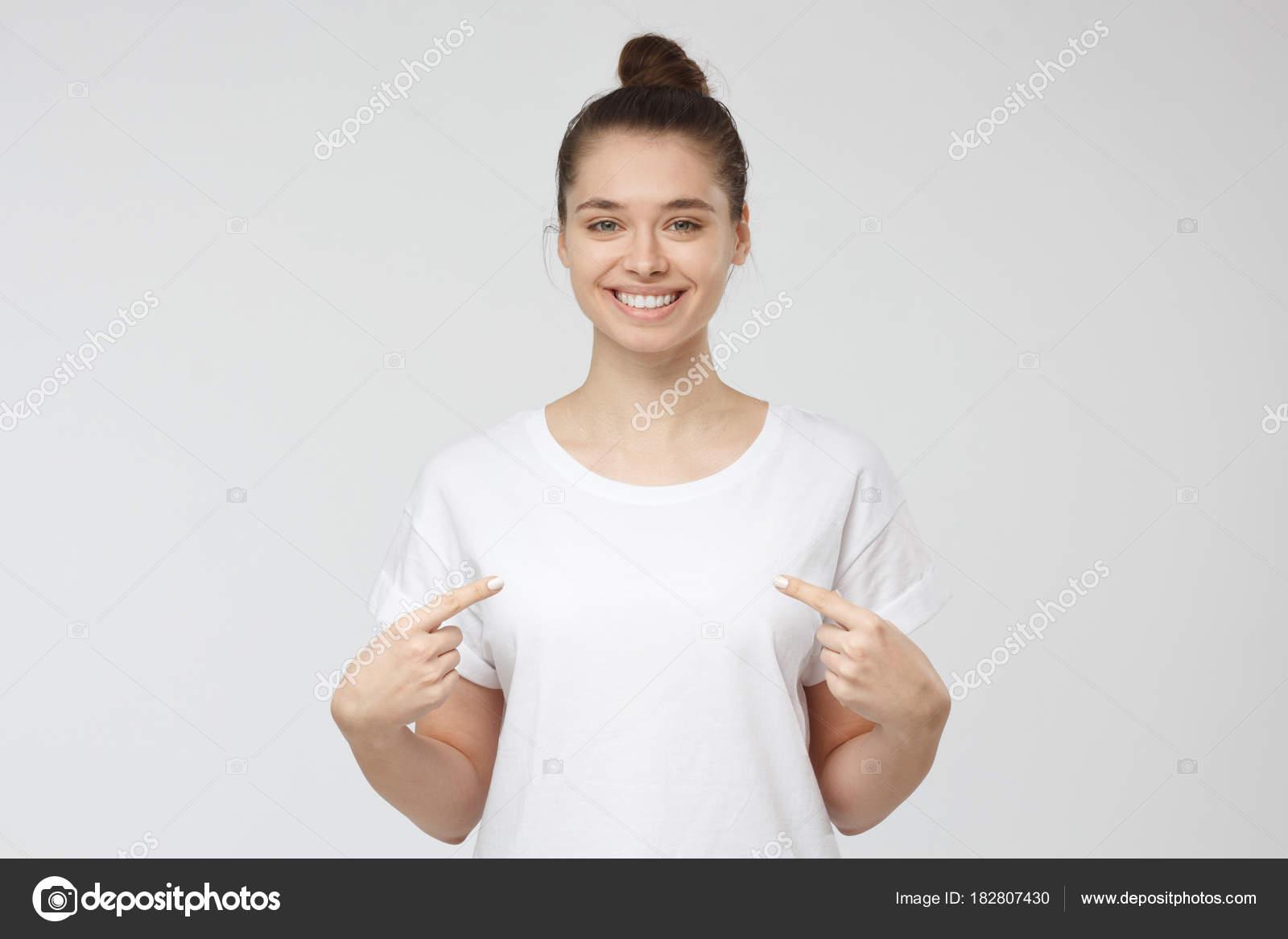 depositphotos_182807430-stock-photo-smiling-nice-woman-pointing-at.jpg